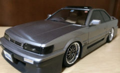Gray Nissan Leopard scale model