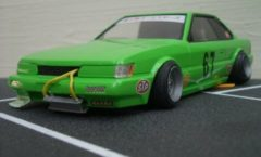 Green Nissan Leopard scale model