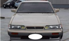 Beige with dark grey 2 tone Nissan leopard XS